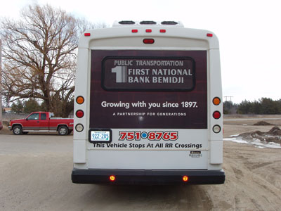 Paul Bunyan Transit - Advertisements on back of bus.